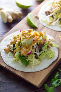 Ginger beef tacos with Peanut Sauce on wood serving board Asian Recipes, Mexican Food Recipes, Beef Recipes, Cooking Recipes, Tilapia Recipes, Budget Recipes, Kitchen Recipes, Ginger Beef, Spiced Beef
