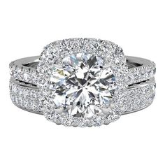 For a stunning handcrafted bridal set, pair a Ritani French-Set Halo Diamond Band Engagement Ring with a Women's Double Micropavé Diamond Wedding Ring. Available in Platinum (0.70 CTW) for a Round Center Stone