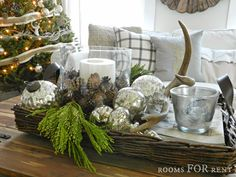 White, silver, and wood- lovely home decked out for the holidays.