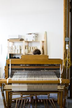 """Warp threads on a back beam: """"I discovered weaving at art school. I was taking classes in fiber already, and in intro everybody gets their little frame loom, you get to try it out. But as soon as I did that I just moved immediately to the floor loom and kind of went from there,"""" says Duvall. She recalls the weaving studio in college, in a """"lift above the rest of the department,"""" she says. """"You could always hear the clanging."""""""
