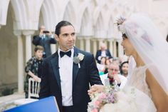 Groom wears a navy blue tuxedo and bowtie | Photography by http://www.roncaglioneweddingphotographers.com/