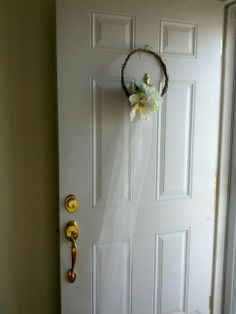 Wreath for the door made from tulle, grapevine wreath and some silk flowers