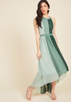<p>Feel like royalty in this airy colorblocked maxi - part of our ModCloth namesake label! Featuring roomy pockets, a gathered waist, and an elegant high-low hem, this sage and forest green dress will have you radiating beauty and kindness throughout the land!</p>