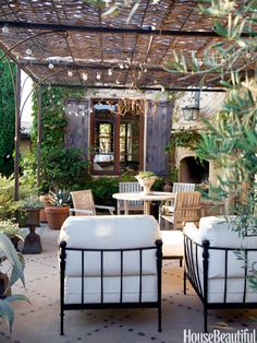A chandelier and string of lights add even more romance to the patio of a Corona del Mar, California, house. Design: Dana Abbott and Kim Fiscus
