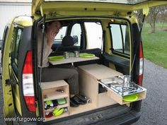Pull out kitchen and table. Maybe some good ideas for a truck bed in here...