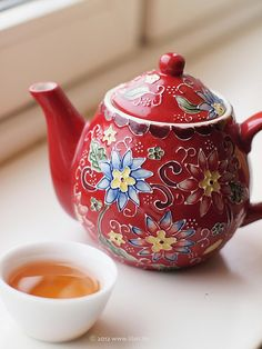 red floral teapot