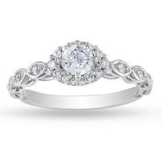 Miadora 10k White Gold 1/2ct TDW Diamond Halo Ring (G-H, I2-I3) - This ring is totally adorable and comparatively inexpensive. LOVE IT.