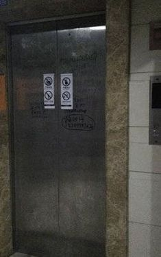 At a residential building in Xi'an, China, two workers shut down an elevator for maintenance on January 30. They shouted into the sealed car to make sure no one was inside.
