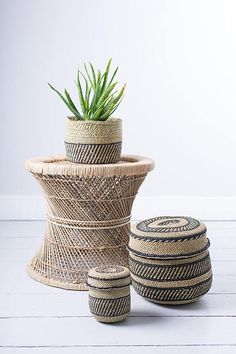 Woven from reed-like milulu grasses found in swamps and riverbeds, our NYUMBA baskets are hand woven with black patterned stripes against a natural base. Ethical and practical, these lidded baskets make ideal home storage for the kitchen, the bathroom and even the nursery. In their