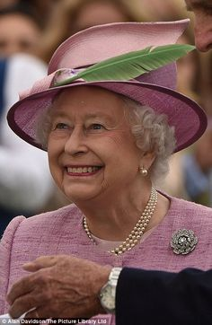The Queen beams at the winners at the Cartier Queens Cup Polo Final...