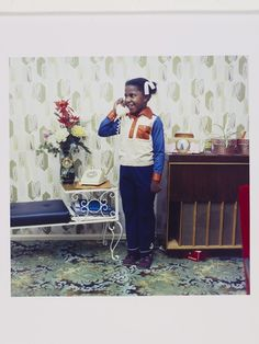 Neil Kenlock, Untitled, A young girl speaking on her parents' telephone in South London, 1973