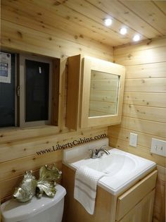 This is the a Tiny House on Wheels by Liberty Cabins that features the much-desired downstairs bedroom. The home also has a loft accessible by a standard ladder, but for those wary of climbing up a…