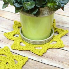 I don't stop crocheting just because the weather gets warmer ... I just think of cooler projects to crochet! I aim for lightweight, portable, and of course bright sunshine-y colors. I had a fun lime green cotton yarn begging to be used so I made up some chunky doilies to place around the house. And of course I wanted to share my crochet doily patterns with you :)