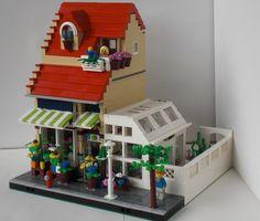 Pretty little Flower Shoppe by Alison WIlley. Looks like a residence on Lego Display, Lego Modular, Lego Design, Legos, Lego Flower, Casa Lego, Flower Shop Decor, Big Lego, Lego Club