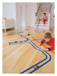 FamilyFun - Give kids a roll of painters tape and let their imagination take over.