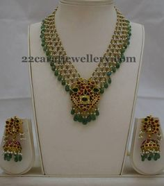 Small pearls bunches and emerald drops combination pretty short necklace with burma rubies studded peacock pendant with kundan work in th...