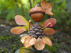 Woodland Fairy made from a pinecone, acorn, and other nature items. Great fall craft!
