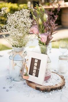 Romantic & Rustic Garden Wedding in California | Confetti Daydreams - Framed scrabble and blackboard wedding table number sign displayed upon a slice of tree trunk, alongside Baby's Breath and colourful flowers ♥  ♥  ♥ LIKE US ON FB: www.facebook.com/confettidaydreams  ♥  ♥  ♥ #Wedding #RealBride #RusticWedding #PastelWedding #GardenWedding  #OutdoorWedding