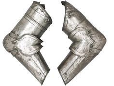 A pair of German Vambraces from a 'Black and White' Armor, c. 1580, pos. Brunswick, with minor differences, each formed of a tubular upper and lower cannon, the former fitted with a turner of three lames on the left and two on the right, bracelet couter of three lames (one patched), and the main edges with roped inward turns