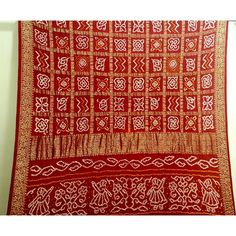 Red Gajji silk Gharchola saree. Blouse piece is included.
