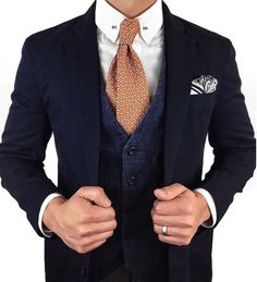 Vintage print tie paired with a vest and blazer.