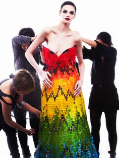 TWELV Magazine recreated Alexander McQueen's infamous rainbow feather dress out of 50,000 gummi bears.