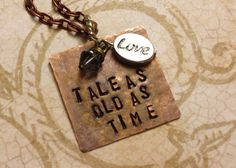 Hand stamped Tale as Old as Time: Beauty and the Beast quote pendant/charm