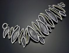 Davide Bigazzi.  Sterling silver and 18k gold Bracelet.  See too Wiwat's polymer work.
