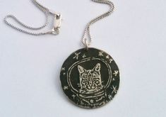 """Saturn 5 Studio introduces this pendant this way: """"This is Ground Control to Major Tom...cat."""""""