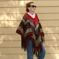 Girls and Grannies - a free crochet poncho pattern from Roving Crafters.