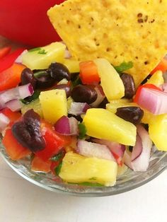 This easy pineapple salsa only takes a few minutes to throw together. Basically, you just add all the ingredients to a bowl and mix well. It's a refreshing, flavorful snack or appetizer that's a pleasant variation of traditional chips and salsa. This pineapple salsa is one of my favorite snacks. It's a marriage of the tropical flavors I love with my favorite Mexican ingredients. It's colorful, flavorful, and a blend of different textures. Basically, it's a food fiesta you can enjoy in…