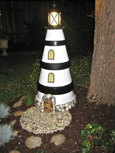 Terra cotta pot lighthouse really lights up the night!