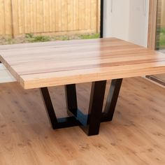 Wormy chestnut square dining table with gloss black legs