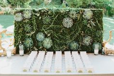 How gorgeous is this wall of succulents and greenery? Ask your florist to mimic this floral wall with your favorite buds.