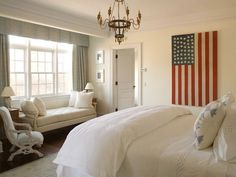 Crisp white guest bedroom. Perfect canvas for an American flag. Room by Phoebe Howard.