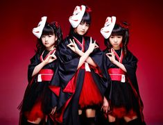 "BABYMETAL ""MEGITSUNE"" Japanese metal group with poppy teenage female vocalist and positive, upbeat lyrics"