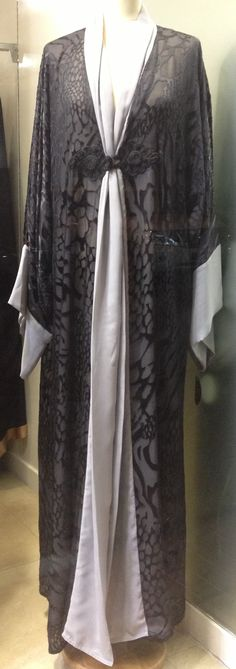 Beautiful black  and grey abaya in double layer.Crochet detail buttons.Front open style.  made to measure and shipped worldwide.  check out more on  www.theabayacompany.blogspot.com