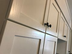 New oak shaker doors finished in Target Coatings Emtech 6500 and clear coated in Emtech 9300 satin in Benjamin Moore Simply White. Target Coatings have the finest waterborne lacquers on the market hands down.
