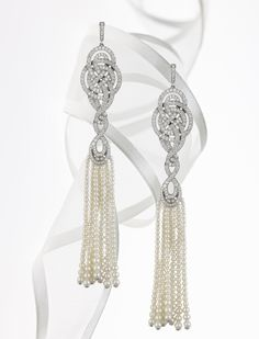 Garrard white gold earrings with diamonds and pearl tassels, the Entanglement collection