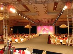 Fashion show through a dinner set-up. It could use some more decor, but I like the concept!