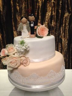 Two-tier wedding cake with peach and lace detail #whippedwithlove #sugarlace #peach