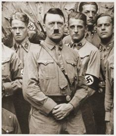 Adolf Hitler poses with a group of Nazis soon after his appointment as Chancellor. - (Picture courtesy of USHMM Photo Archives.)