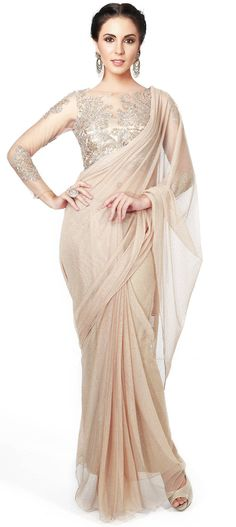 Buy Online from the link below. We ship worldwide (Free Shipping over US$100). Product SKU - 300365.Product Link - http://www.kalkifashion.com/gold-saree-matched-with-embellished-blouse-only-on-kalki.html