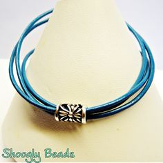 Turquoise Leather and Sterling Silver Triple Wrap Bracelet