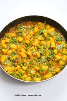 Vegan Bombay Potatoes and Peas Easy Indian Spiced Potato and Pea curry. Pea Recipes, Veggie Recipes, Whole Food Recipes, Vegetarian Recipes, Cooking Recipes, Healthy Recipes, Vegan Foods, Vegan Dishes, Potatoes And Peas Recipe