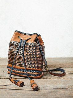 Jaque Mochila Woven Bucket Bag | American made leather bucket bag in a gorgeous hand-woven design, featuring braided trims and a drawstring closure with oversized statement tassel pulls. Includes a canvas dust sack.