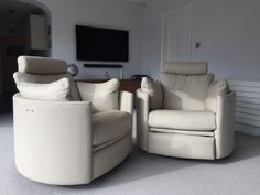 Leather electric, swivel recliner curved armchairs - excellant for zoning off a large space