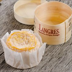 Langres Chalancey: The golden rind has been washed in champagne brandy and envelopes a creamy, silky smooth, ivory interior. For a dynamic presentation, pour a splash of Champagne into the cheese's top crater and watch the bubbles dance. Visually stunning and delicious!