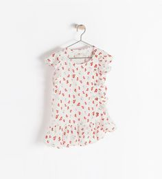 Image 1 of PRINTED BLOUSE WITH FRILL ON THE SIDE from Zara