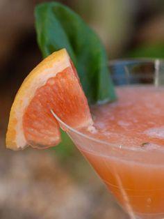 Pink Sapphire. Belvedere Pink Grapefruit vodka,  Bombay Sapphire,  Aperol (an Italian Aperitif),  grapefruit chunks, lime juice, simple syrup, 1 basil leaf